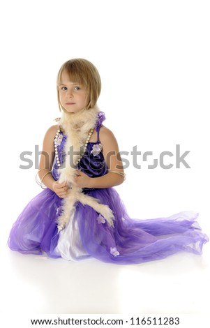 A pretty young girl playing dress-up in a formal purple dress, necklace, bracelets, and a boa.  On a white background,.
