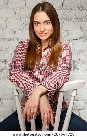 a pretty young girl smiling, looking at the camera - stock photo