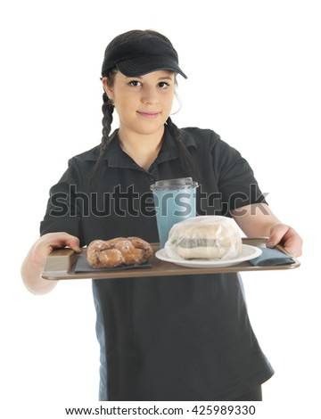 A pretty young waitress handing the viewer a tray with a wrapped breakfast sandwich, a twisted donut and cup of coffee.  On a white background. - stock photo