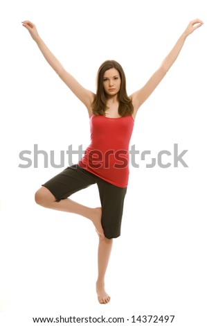 A pretty young woman doing yoga - stock photo