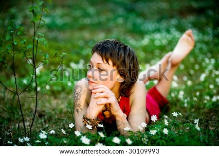 A pretty young woman having fun of resting  in the countryside