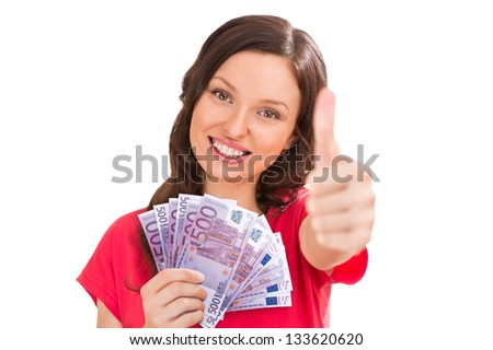 A pretty young woman holding a fan of euro bills and thumbs up - stock photo
