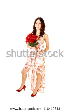 A pretty young woman in a evening dress, long in the back short in the front, with a bunch of red roses, for white background.