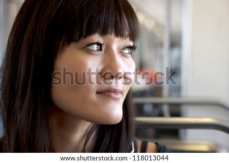 A pretty young woman travels on the train. - stock photo