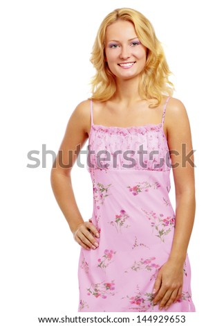 A pretty young woman wearing a nice summer dress, isolated on white