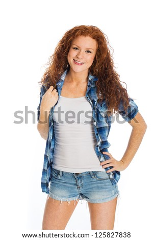 A pretty young woman with a friendly smile and beautiful, naturally curly hair. - stock photo