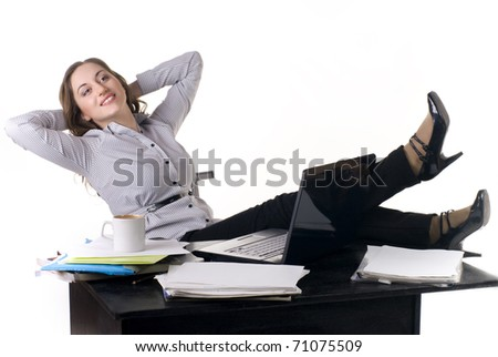 A pretty young woman working and rest on computer