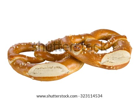 A pretzel is a type of baked bread product made from dough most commonly shaped into a knot, isolated on white background.