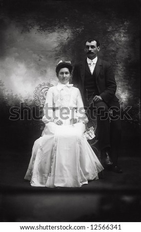A print from a glass negative taken in an an old view camera about 1890. A wedding photo of a couple. - stock photo