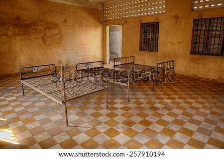 A prison room in the famous S-21, a school turned into a prison and torture center by the Khmer Rouge during the Cambodian genocide - stock photo