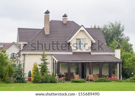 a private house and its beautiful garden - stock photo