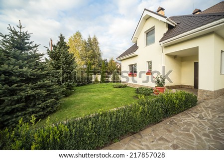 a private house with garden - stock photo