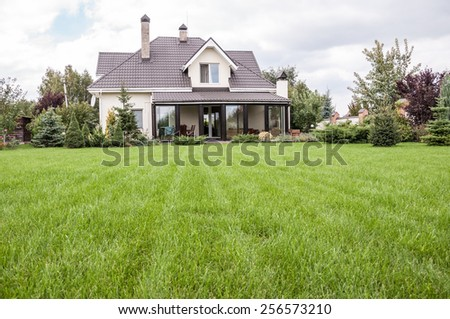 A private house with its garden in a rural area - stock photo