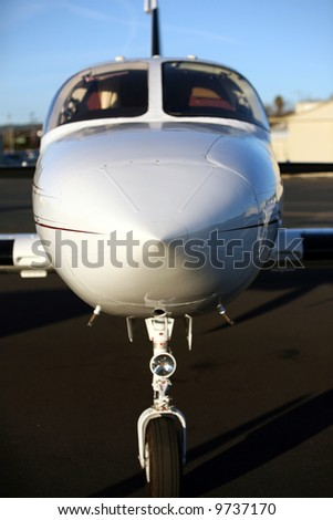 a private jet sits in an air field - stock photo