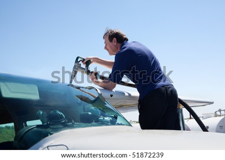 A private pilot makes a pit-stop to refuel his airplane. - stock photo