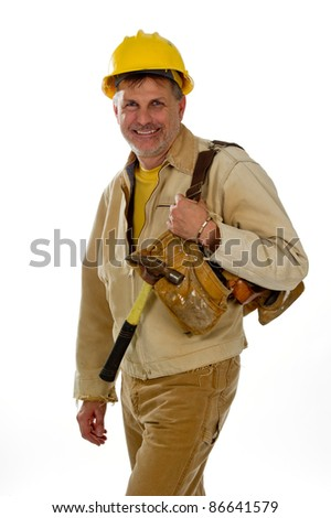 A professional male construction contractor worker is wearing a hard hat and holding a tool belt. - stock photo