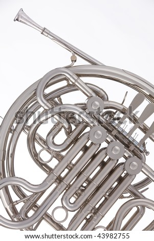 A professional silver French  horn isolated against a white background. - stock photo