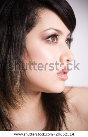 A profile shot of a beautiful asian girl - stock photo