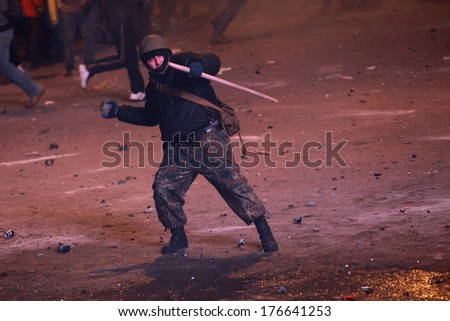 A protester throws a stone at police. Kyiv, Ukraine, January 19, 2014