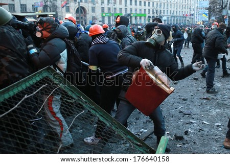 A protester throws stones at police. Kyiv, Ukraine, January 20, 2014 - stock photo