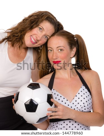 A proud mom and her daughter the soccer player - stock photo