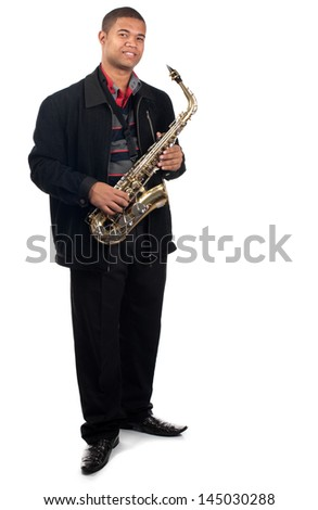 A proud young saxophonist holds his instrument. - stock photo