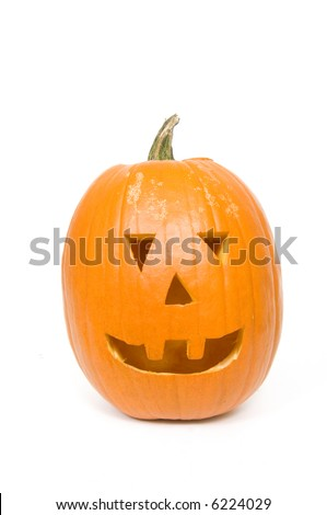 A pumpkin carved for halloween on white background
