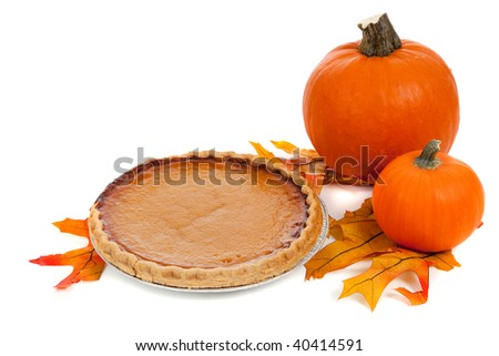 A pumpkin pie with pumpkins and fall leaves on a white background - stock photo