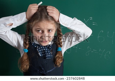 a pupil at the school board - stock photo