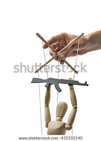 A puppet with  gun in the hands of the tyrant on the isolated white background - stock photo
