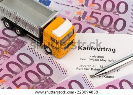 a purchase contract for a new truck. invest in new vehicles brings cost advantages. - stock photo