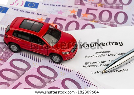 a purchase contract to buy a car at the car dealer. new and used cars - stock photo