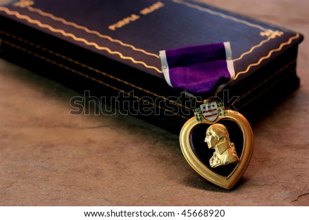 A Purple Heart Military Decoration Draped in Front of its Box 2