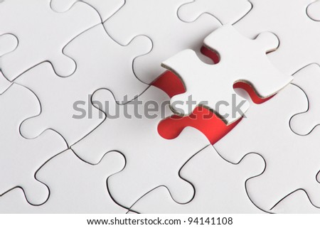 a puzzle with missing parts - stock photo