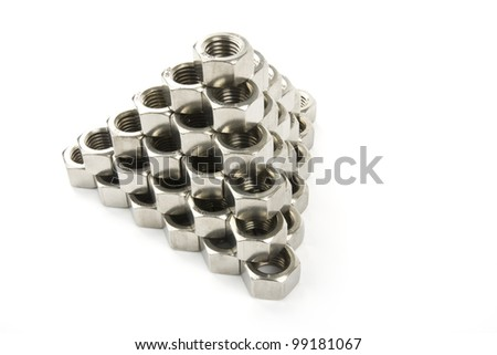 A pyramid of hexagonal nuts on a white background shown.
