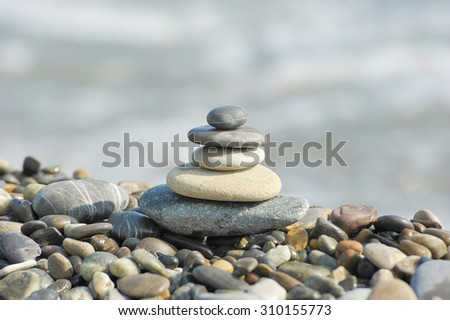 a pyramid of sea stones