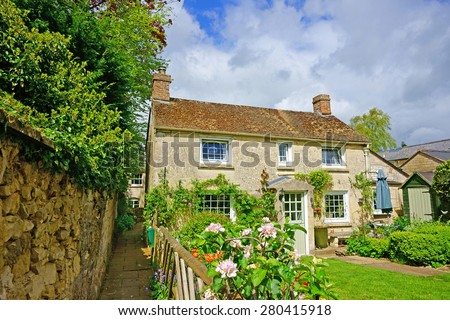 A quaint individual Cotswold country cottage in the heart of the Cotswolds, Gloucestershire, United Kingdom - stock photo