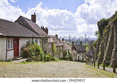 A quaint rural village street in England, Gold Hill in West Sussex. This iconic street is famous for its use in a 1970's TV advert. - stock photo