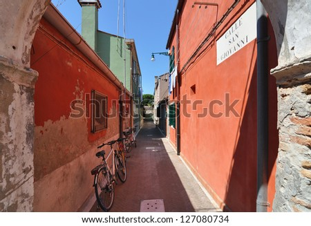 A quiet colorful alley in Venice, Italy - stock photo