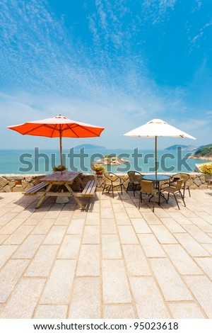 A quiet picnic area viewpoint in Qinbi village offers a place to rest and enjoy the view of Turtle island. Qinbi, a preserved stone village, is the top tourist destination on Matsu Island in Taiwan - stock photo