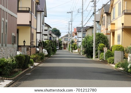A quiet street houses on either side, in japan