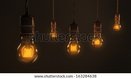 A quintet of vintage hanging light bulbs over a dark brown background - stock photo