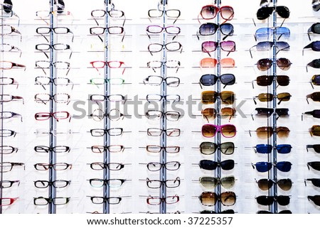 A rack of eyeglasses in shop - stock photo