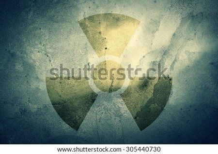 A radiation warning symbol on a grunge background.            - stock photo