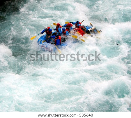 a raft blasting through a wave - stock photo