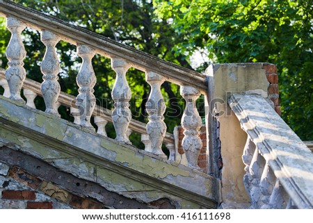 A railing of the old ruined stone staircase of the palace - stock photo