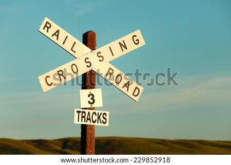 A railroad crossing sign out west. - stock photo