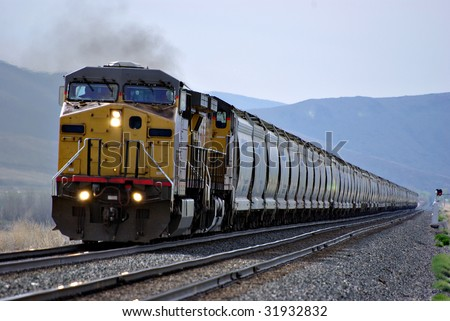 A railroad train coming down the tracks - stock photo