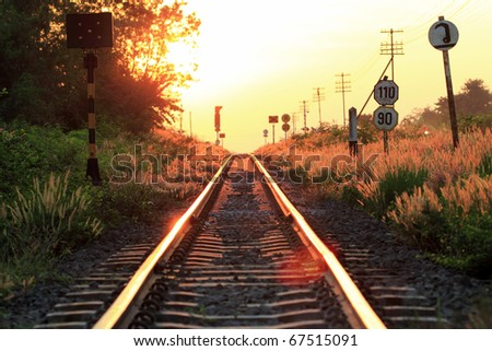 a railway in sunset - stock photo