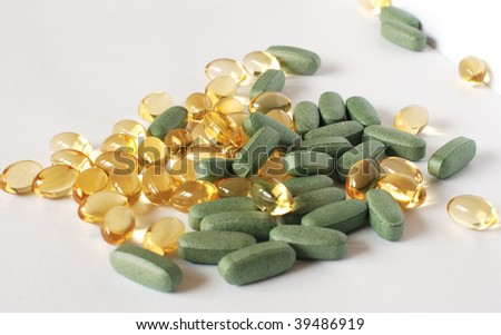 A random pile of dietary supplements - stock photo